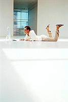 Businesswoman using computer on floor