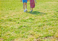 Girls walking on lawn