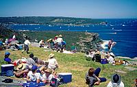 People with picnics watching Sydney _ Hobarth boat race. Spit Bridge Walk,Manly.