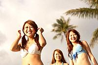 Young women standing in bikini, Guam, USA