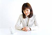 Businesswoman looking at mobile phone