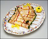 Raw fish kebabs with ice on platter