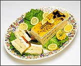 Three layers fish terrine and slices on platter