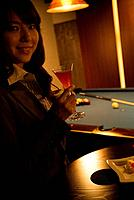 Businesswoman drinking a cocktail at a bar