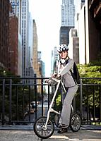 Mid_Adult Businesswoman with Bicycle