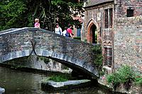 Tourists on the Bonifacius bridge over canal in Bruges, Belgium