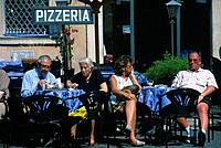 Piazza Navona/ square. People eating/ drinking at outside cafe. Pizzeria sign.