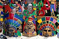 Close_up of traditional brightly painted masks. Primary colours. Local craft.