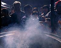 Senso_Ji. Incense cauldron. People purifying themselves with smoke.