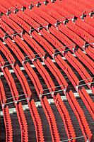 Rows of empty seats at a football stadium.