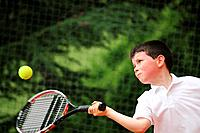Boy Hitting Forehand Shot