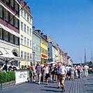 Nyhavn. Pedestrianised old canal area. Colouful buildings. People.