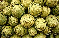 Yehuda market. Stall. Display of artichoke heads for sale.