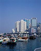 Typhoon shelter. Protected moorings. Houseboats,speed boats,fishing. Tall buildings. Elevated road
