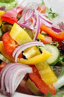 close up image of pepper and red onion salad