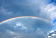 Rainbow across clouds