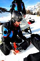 Ski rescue. Ski patrol attending an injured skier.