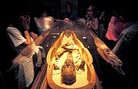 Ramases II mummy. Tourists viewing the mummified remains of the Egyptian Pharaoh Rameses II 1301_1235 BC. Rameses II was the third pharaoh of the 19th...