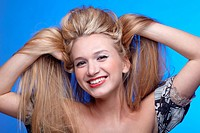 beautiful blonde touching hair