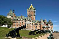 Chateau Frontenac with canons in foreground in the old upper town of the city of Quebec