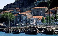 City. River Douro. Port making region. La Ribeira. Waterfront. Wooden masted port boats,barrells on deck.