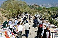 Ancient Zapotec capital. Archaeological site. Temple entrance. Path. Stalls. People.