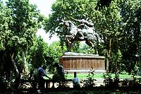 Capital city. Statue of Amir Timur,Temur. Tamerlane. Medieval Asian warrior leader. Horseman. Park. Trees.