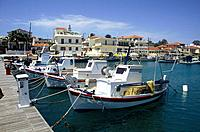 Ionian island,Cephallonia. Harbour,waterfront. Painted fishing boats. Houses