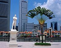 There is a large white marble statue of Sir Stamford Raffles on the banks of the river with a view to the modern Central Business District region of t...