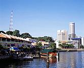 The Singapore River flows past the central business district,by North Boat Quay and the old merchant stores and warehouses,called go downs,and further...