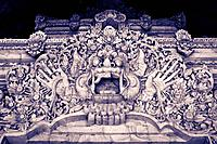 Balinese fierce creature in stone above entrance