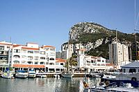 Gibraltar town is a British overseas territory,at the base of a huge rock,The Rock of Gibraltar,on the Iberian peninsula. Date shot September 2008