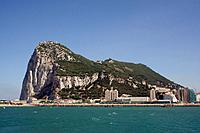 Gibraltar town is a British overseas territory,at the base of a huge rock,The Rock of Gibraltar,on the Iberian peninsula