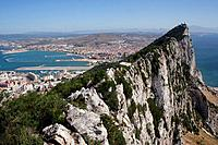 The Top of the Rock. Gibraltar town is a British overseas territory,at the base of a huge rock,The Rock of Gibraltar,on the Iberian peninsula. Date sh...
