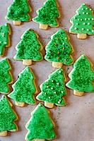 Decorated holiday cookies in the shape of Christmas trees
