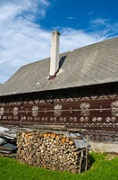 Pile of firewood in front of typical brown wooden house Cicmany village Žilina region Slovakia Europe