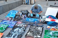 Spray painter working on the street, Kärntner-strasse, Vienna, Austria