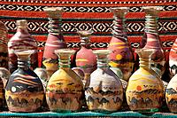 pictures of landscape and camels made of coloured sand in jars, for sale to tourists in Petra