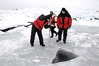 Ice Diver preparing Ice Hole, White Sea, Karelia, Russia