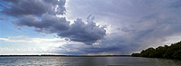 Panorama of lakes and channels in the Danube Delta, romania, thunderstorm clouds form in the air, which is full of moisture from the huge evaporation ...