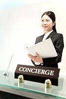 Female Concierge with File