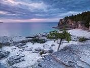 Beautiful sunset scenery of Georgian Bay rocky shore  Bruce Peninsula National Park, Ontario, Canada