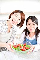 Mother and daughter making salad, Hyogo Prefecture, Honshu, Japan