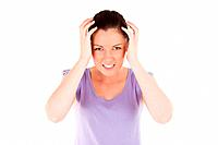 Attractive woman having a migraine while standing against a white background