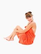 Beautiful young woman in bath towel