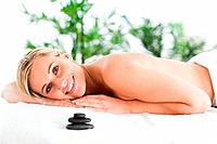 Good looking blonde woman lying on a lounger in a wellness center