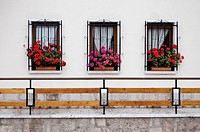 Window boxes bursting with flowers in Nueva de Llanes, Asturias, Spain