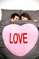 Couple under blanket reading 'love'