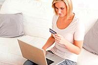 Close up of a woman shopping online in her lving room