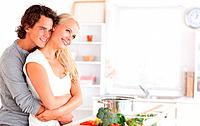 Cute couple posing in their kitchen